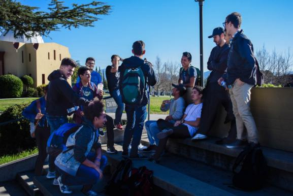 Students hang out in the historic Greek Theatre during a break between classes