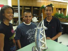 three architecture students pose with their tower project
