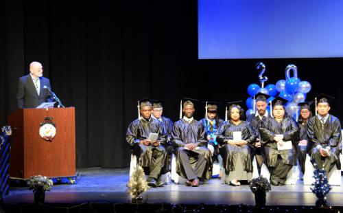 Program Director Dennis Jackson congratulates psychiatric technology graduates during their graduation in December 2016.