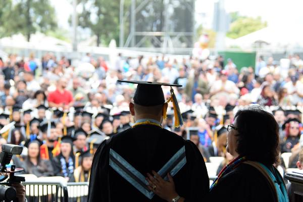 President Diana Z. Rodriguez congratulates a graduate during Commencement 2017.