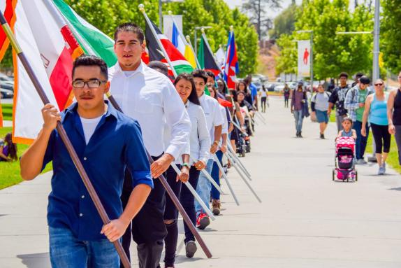 Students walk in a flag parade