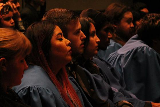 Audience members listen to the combined choir on December 16.