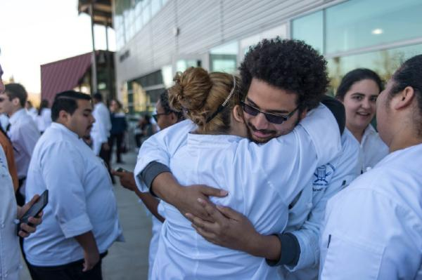 SBVC culinary arts students hug after a stressful competition.