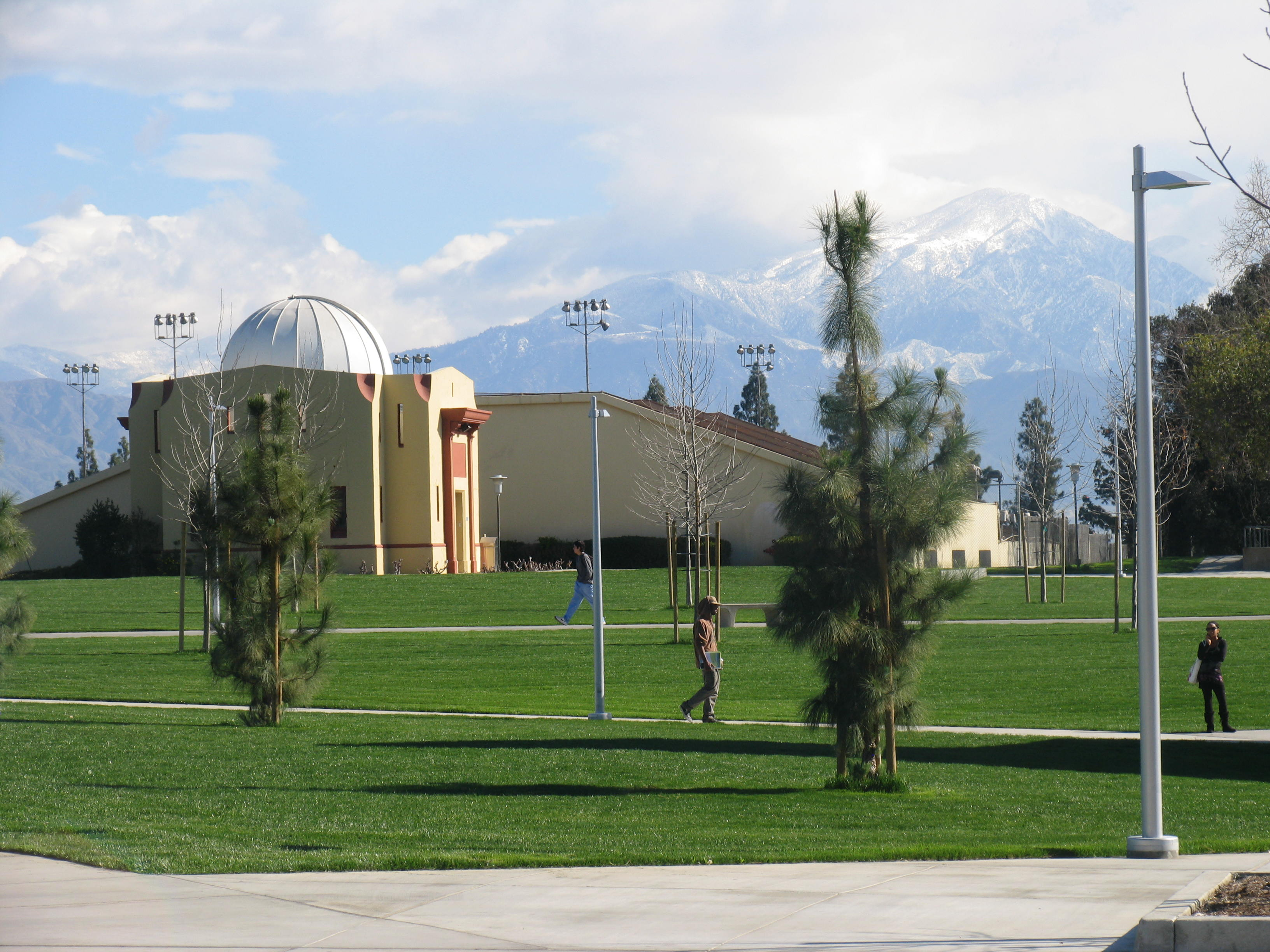 observatory building and snowy mountains