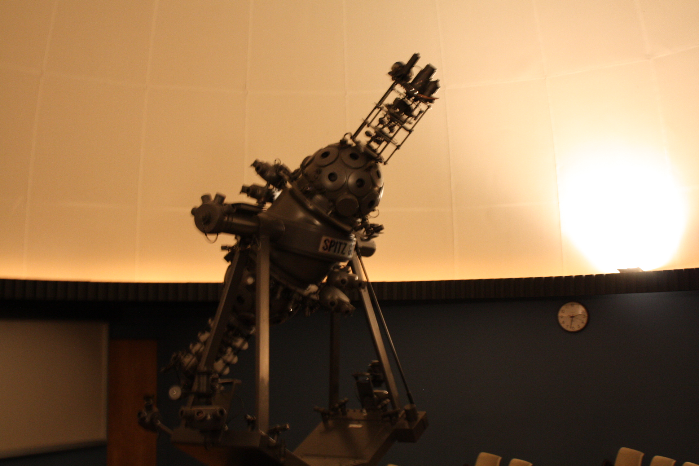 star projector inside planetarium