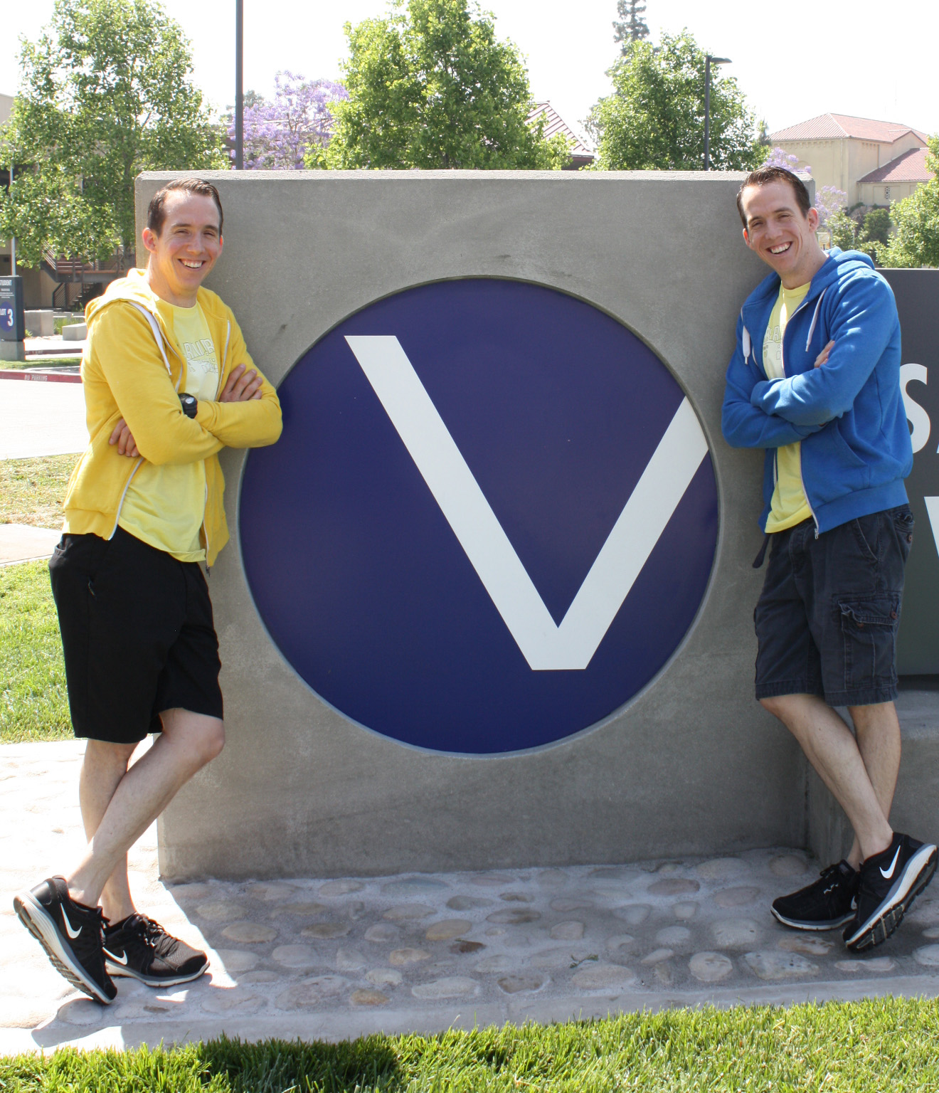 darrell and daniel peeden in front of SBVC v-ball signage